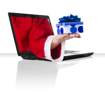 black laptop with Santa holding a present wrapped in blue