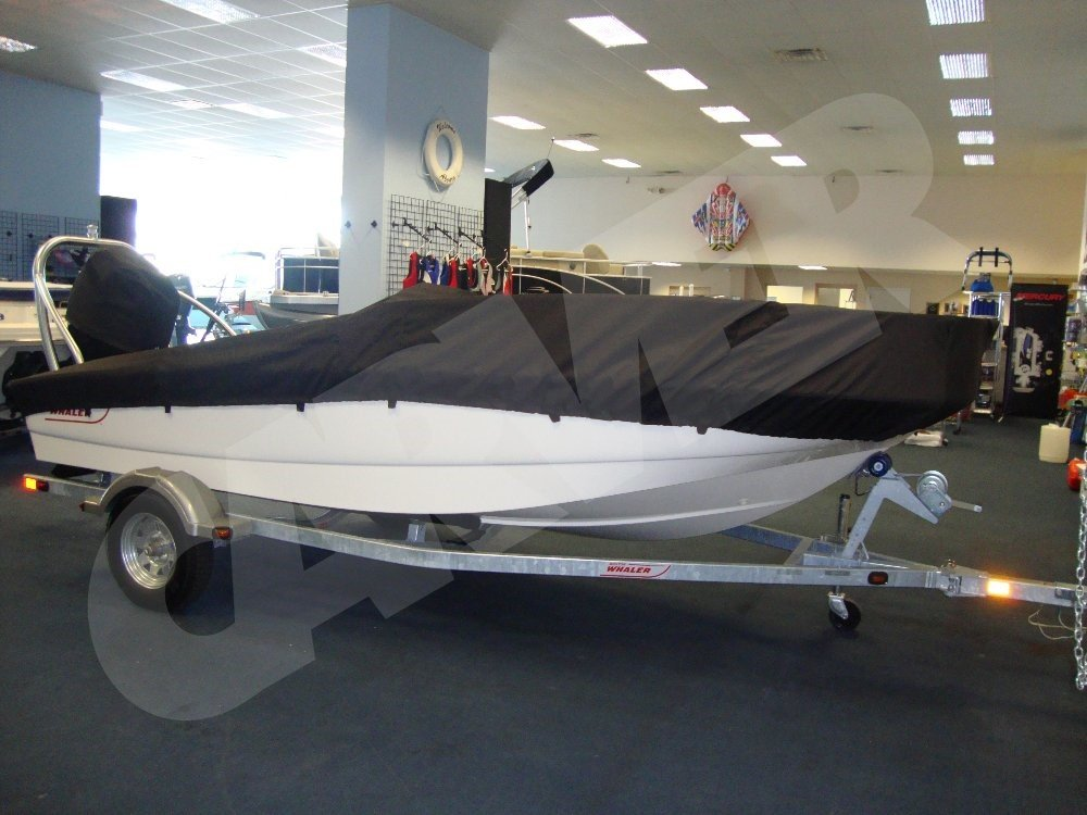 white boston whaler boat with a black boat cover