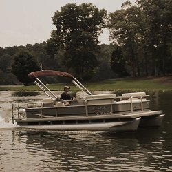 boat-with-pwr-arm-ii-bimini-folded-back-with-boot