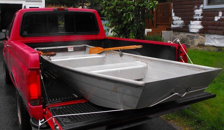 John boat in back of truck