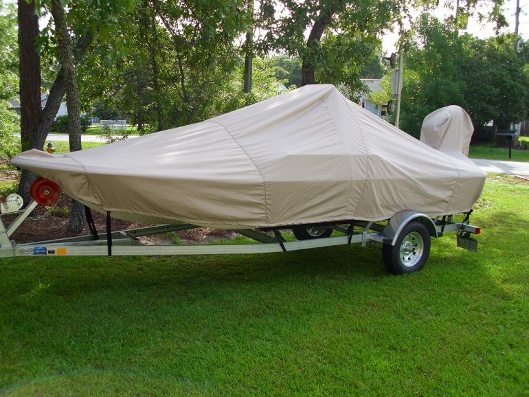 Carolina Skiff JV 17 CC with beige Carver Performance Poly-Guard boat cover